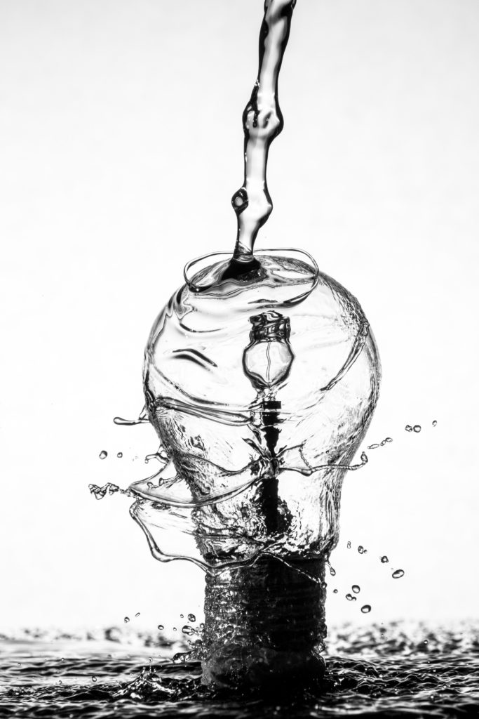 water pouring on lightbulb