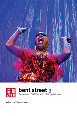 "Cover of Bent Street magazine Volume 3 features dark-skinned drag queen in sequinned red dress with arms raised in front of blue and purple backdrop. The cover has the title ""bent street 3"" and ""Australian LGBTIQA+ arts, writing and ideas Edited by Tiffany Jones"""