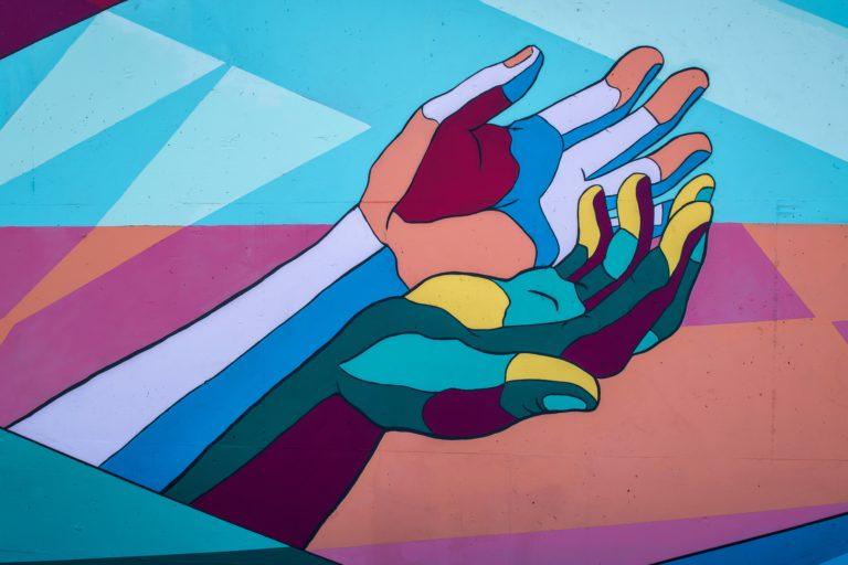 Graphic hands cupped together. Image by Tim Mossholder