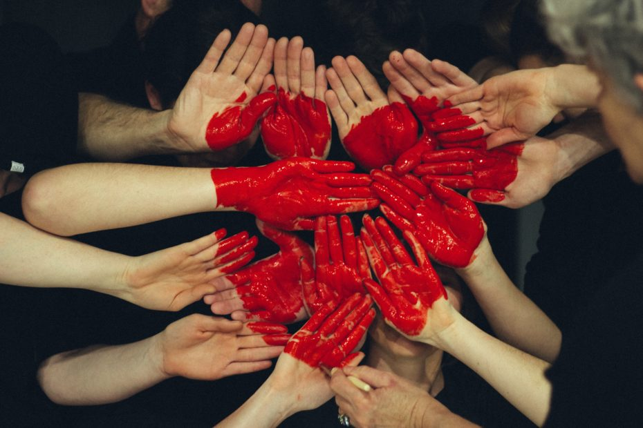 Hands painted with red loveheart. Image by Tim Marshall