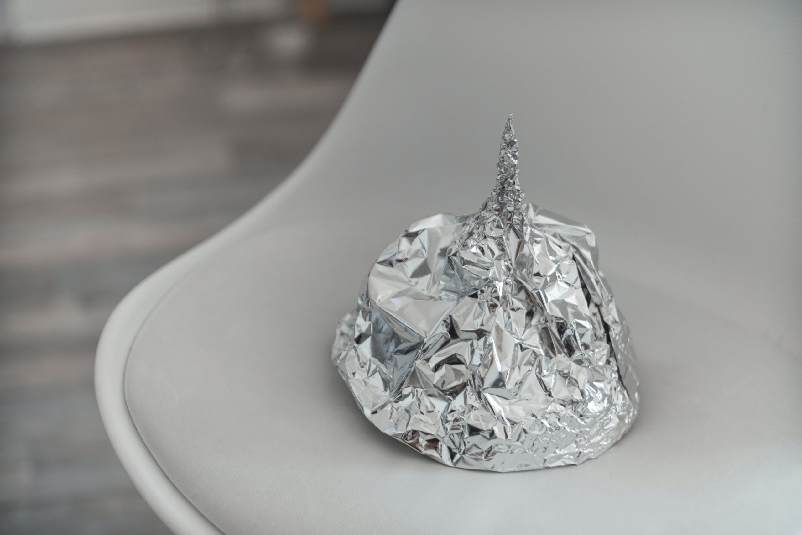 Tin foil hat on chair. Image by Tom Radetzki.