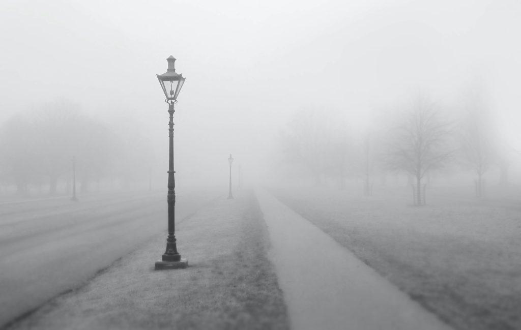 Gaslight alongside pathway in heavy fog_Image by Rory Bjorkman