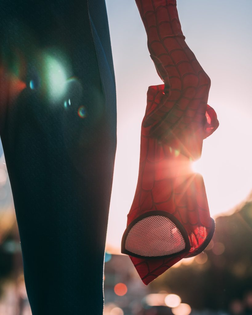 Cosplayer holding Spiderman mask in costumed Hand_Image by Joey Nicotra